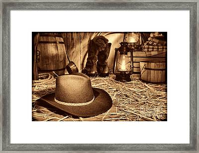 Black Cowboy Hat In An Old Barn Framed Print