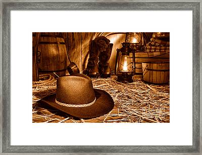 Black Cowboy Hat In An Old Barn - Sepia Framed Print by Olivier Le Queinec
