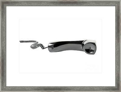 Black Phone Receiver On A White Background Framed Print by Paul Velgos