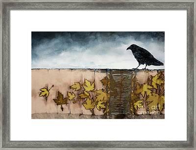 Black Raven Sits Above Scattered Leaves Framed Print