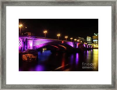 Blackfriars Bridge Illuminated In Purple Framed Print