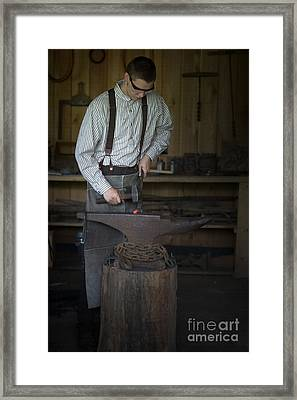 Blacksmith At Work Framed Print by Liane Wright