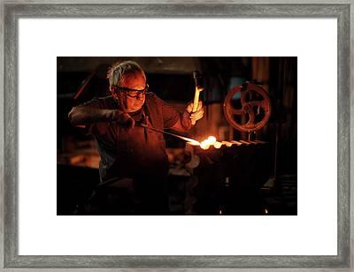 Blacksmith Hammering Red Hot Iron Framed Print