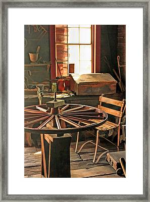 Blacksmith Shop Wheel Repair At Old World Wisconsin Framed Print by Christopher Arndt