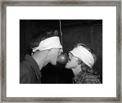Blindfolded Teenagers Try For Apple Framed Print by H. Armstrong Roberts/ClassicStock