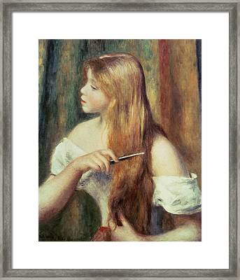 Blonde Girl Combing Her Hair Framed Print by Pierre Auguste Renoir