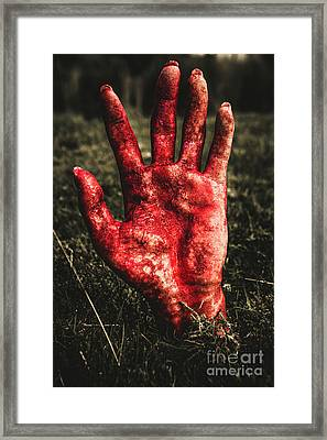 Blood Stained Hand Coming Out Of The Ground At Night Framed Print by Jorgo Photography - Wall Art Gallery