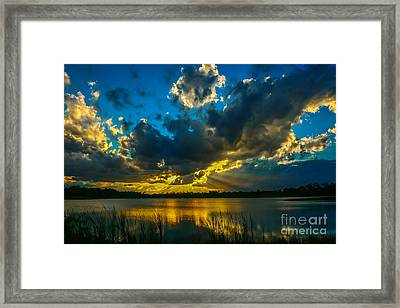 Blue And Gold Sunset With Rays Framed Print