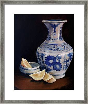 Blue And White Pottery With Lemons Framed Print by Laura Ury