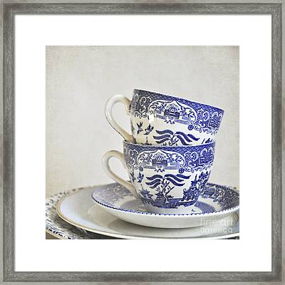 Blue And White Stacked China. Framed Print by Lyn Randle