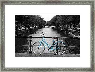 Blue Bicycle By The Canal Framed Print