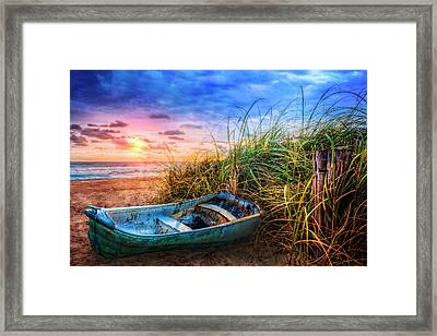 Blue Boat At The Seashore Framed Print by Debra and Dave Vanderlaan
