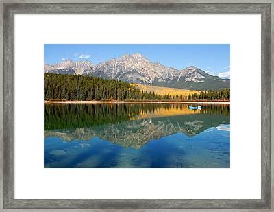 Blue Canoe On Patricia Lake Framed Print