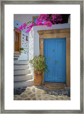 Blue Door And Stairs Framed Print