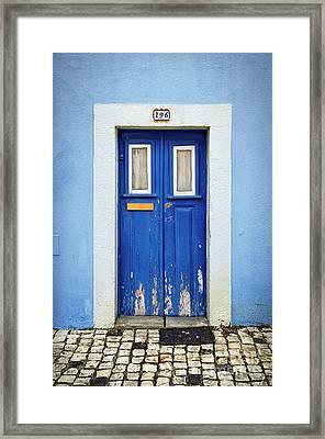 Blue Door Framed Print by Carlos Caetano
