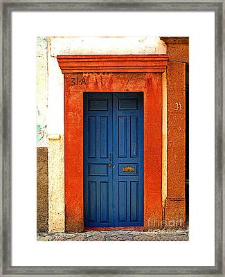 Blue Door In Orange Framed Print by Mexicolors Art Photography