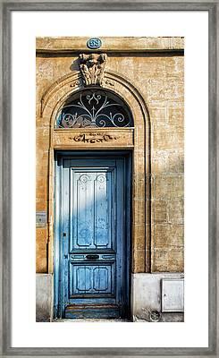 Blue Door In Sunlight Framed Print