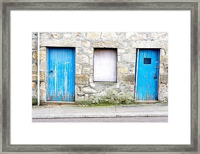 Blue Doors Framed Print by Tom Gowanlock
