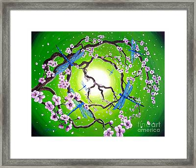 Blue Dragonflies In The Spring Framed Print by Laura Iverson