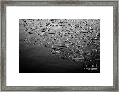 Blue Edge Of Freezing Water On Frozen Small Lake Pond On A Cold Winter Morning In The Uk Framed Print by Joe Fox