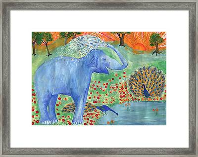 Blue Elephant Squirting Water Framed Print by Sushila Burgess