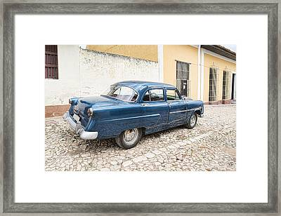 Blue Ford Anglia Framed Print by Sharon Popek