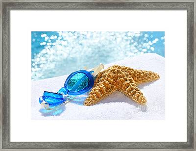Blue Goggles On A White Towel  Framed Print by Sandra Cunningham