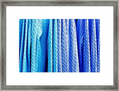 Blue Jumpers Framed Print by Tom Gowanlock