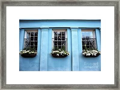 Blue On Rainbow Row Framed Print by John Rizzuto