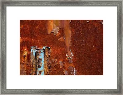 Blue On Rust Framed Print