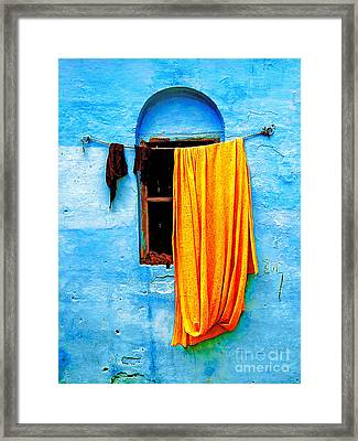 Blue Wall With Orange Sari Framed Print