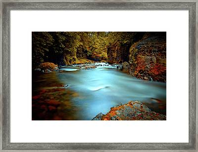Blue Water And Rusty Rocks Framed Print
