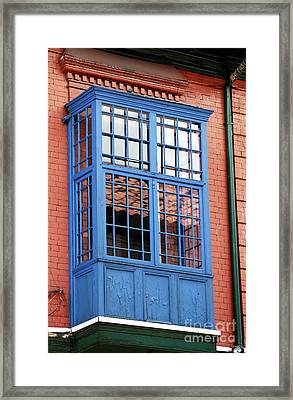 Blue Window In Bogota Framed Print by John Rizzuto