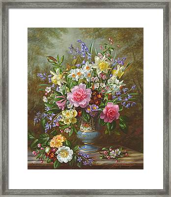 Bluebells Daffodils Primroses And Peonies In A Blue Vase Framed Print