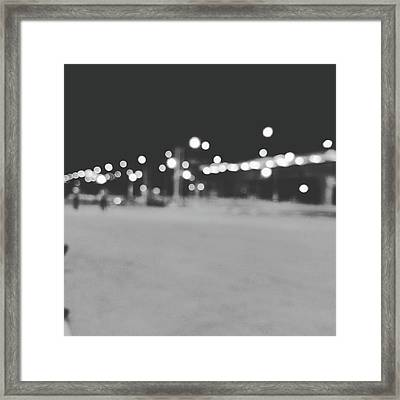 Blurred Lamp Poles On Street At Night  Framed Print by Sirikorn Techatraibhop