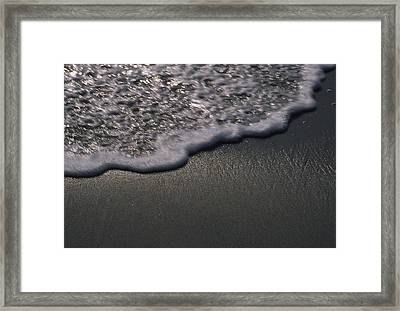 Blurred Motion Of A Wave On The Shore Framed Print by Stacy Gold