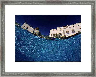 Blurred View Of A Hotel From Underwater Framed Print by Sami Sarkis