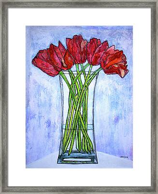 Blushing Red Tulips Framed Print by Janet Immordino