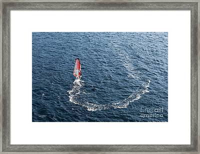 Board Surfing Framed Print by John Greim