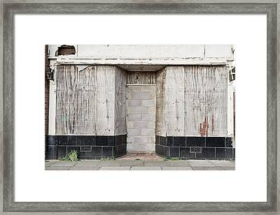 Boarded Up Shop Framed Print by Tom Gowanlock