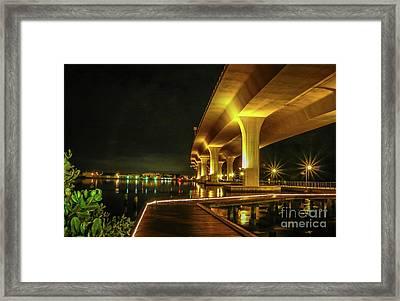 Boardwalk And Bridge At Night Framed Print