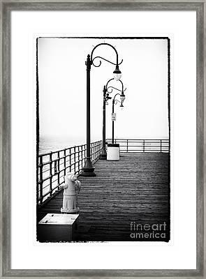 Boardwalk Corner Framed Print by John Rizzuto