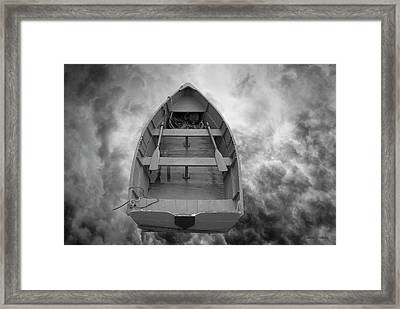 Boat And Clouds Framed Print by Dave Gordon