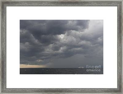 Boat And Storm Framed Print