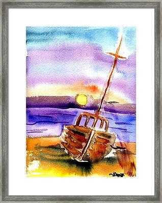 Boat Ashore Framed Print by Janet Doggett