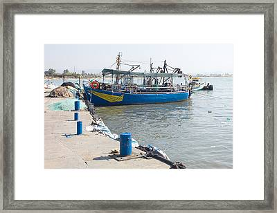 Boat In Blue Framed Print