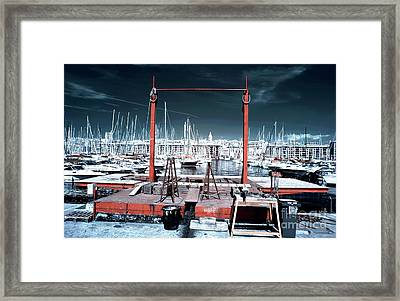 Boat Lift In The Port Framed Print by John Rizzuto