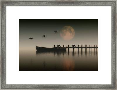 Boat On A Lake With Geese Flying Over Framed Print by Jan Keteleer