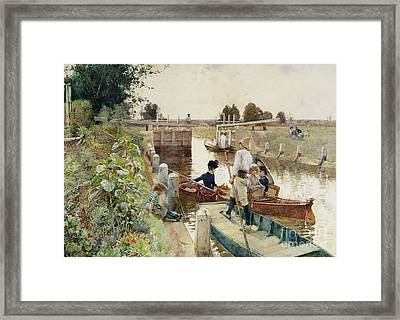 Boaters In A Lock On The Thames Framed Print by Hector Caffieri