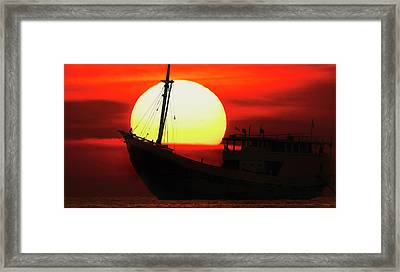 Framed Print featuring the photograph Boatman Enjoying Sunset by Pradeep Raja Prints